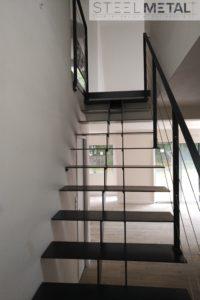 Escalier metal bois à limon central double sur mesure